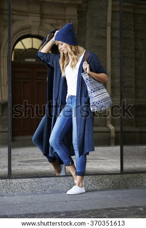 Blond young city girl in blue fashion - stock photo