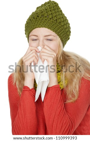 blond young woman with handkerchief catches a cold - stock photo