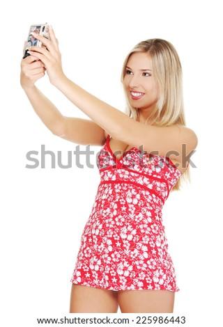 Blonde beautiful woman taking photos - stock photo
