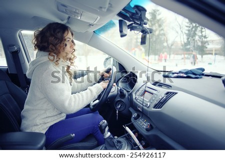 blonde behind the wheel of a portrait - stock photo