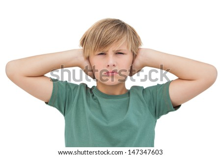 Blonde boy covering his ears on white background  - stock photo