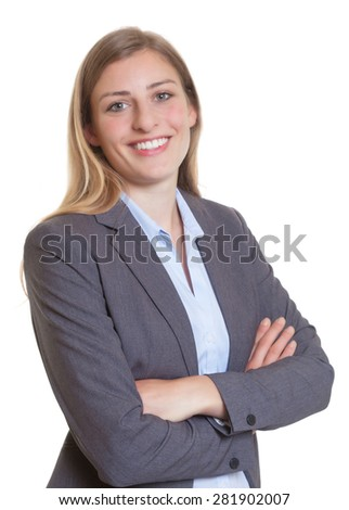 Blonde businesswoman in a blazer with crossed arms - stock photo