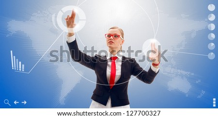 blonde businesswoman wearing red tie and glasses works with the interface of the future, world map here it is - stock photo