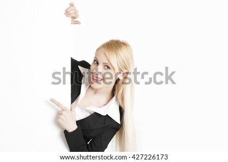 Blonde businesswoman with a big poster isolated on white background - stock photo