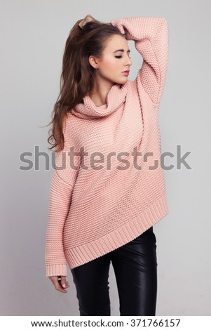 Blonde cheerful young woman. Beauty portrait, perfect makeup. Long chic elegant hair. Model tests. Cute girl in white. Sexy fashion woman. Close-up. Pink pullover. - stock photo