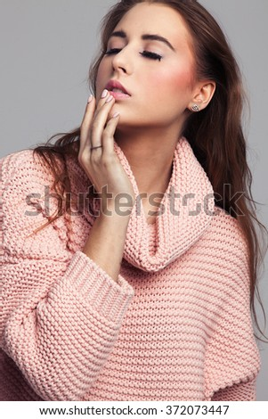 Blonde cheerful young woman. Beauty portrait, perfect makeup. Long chic elegant hair. Model tests. Cute girl in white. Sexy fashion woman. Pink pullover. - stock photo