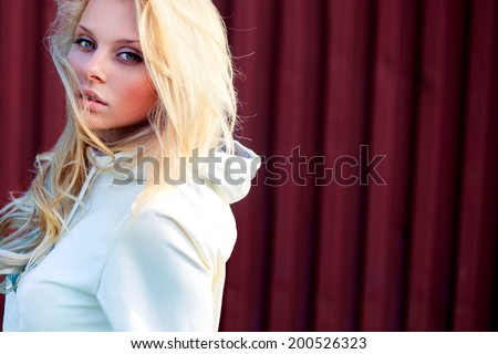 Blonde cute girl fashion look. Photo in the summer park in day light - stock photo