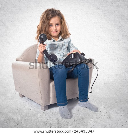 Blonde cute girl talking to vintage phone - stock photo
