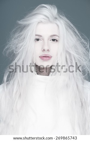 Blonde fashion woman in white coat pink  sexy lips portrait  - stock photo