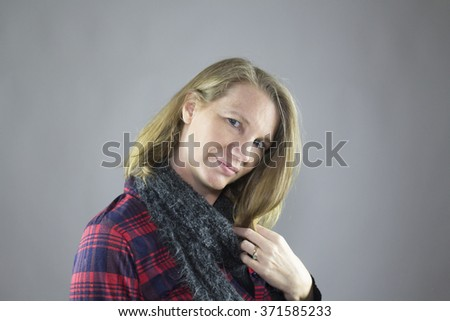 Blonde Female Wearing Blue Scarf and Red Flannel Shirt - stock photo