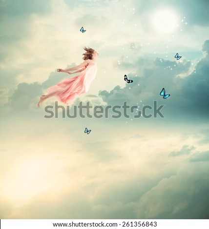 Blonde Girl Flying with Butterflies at Twilight  - stock photo