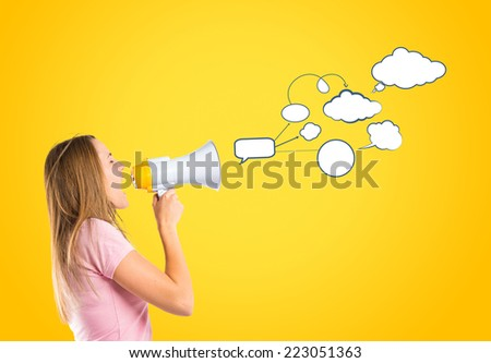 Blonde girl shouting with a megaphone over yellow background  - stock photo