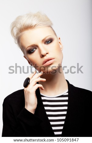 Blonde girl with short hair in suit - stock photo