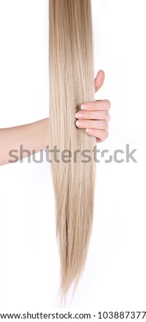 blonde hair extensions in female hand isolated on white - stock photo