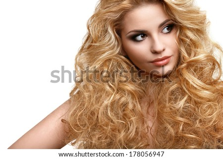 Blonde Hair. Portrait of Beautiful Woman with Long Curly Hair. High quality image. - stock photo