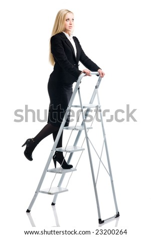 Blonde in a business suit on a step-ladder on a white background - stock photo