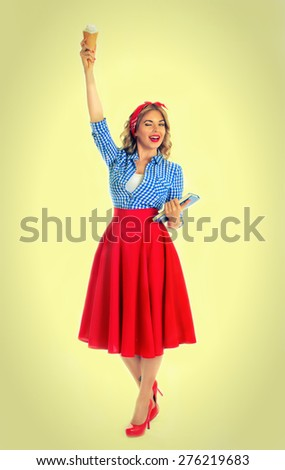 blonde in a pose of Statue of Liberty on a white background Pin-up girl style - stock photo