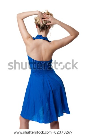 Blonde is back in a blue dress in studio isolated on white - stock photo