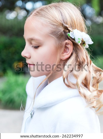 Blonde little girl in the white jacket - stock photo