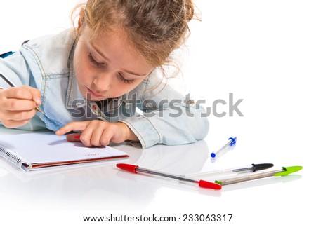 Blonde little girl writing - stock photo