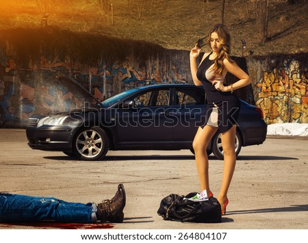 Blonde luxury woman stand over bag full of money amin fuming car outdoors - stock photo