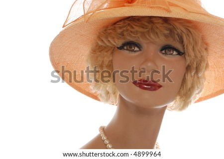 blonde mannequin, large canteloupe hat isolated on white - stock photo