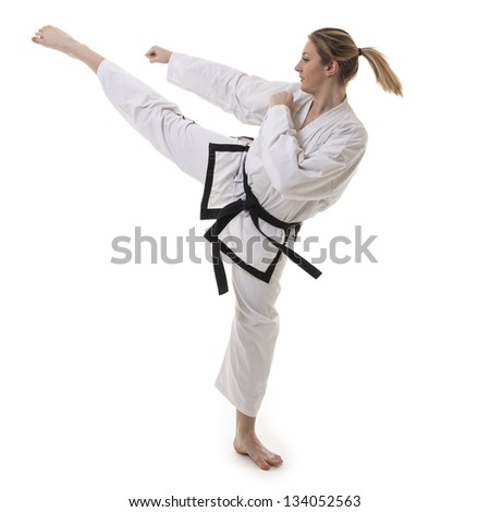 Blonde martial arts girl in kimono exercising karate. Studio isolated portrait. - stock photo