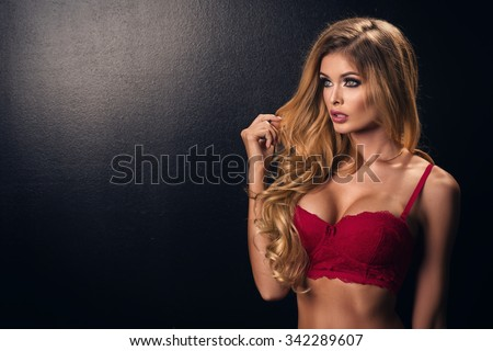 Blonde sexy woman posing in red lingerie  - stock photo