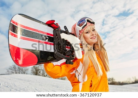 blonde snowboarder on snow - stock photo