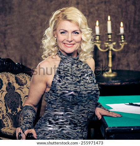 blonde Vintage fashion Senior woman in vintage evening dress. Beautiful woman retro portrait - stock photo