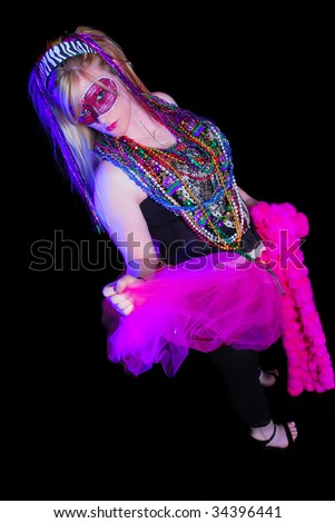 Blonde woman dressed up for Mardi Gras party - stock photo