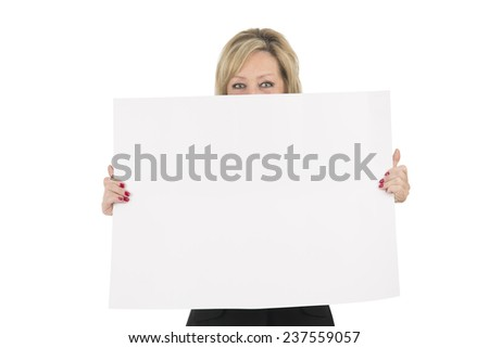 Blonde woman holding a billboard covering her face against a white background - stock photo