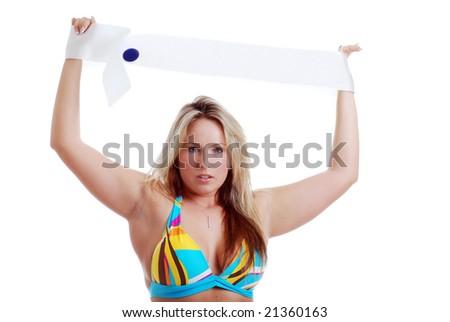 blonde woman holding a sash - stock photo