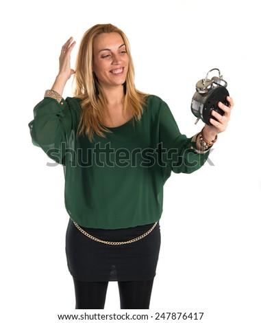 Blonde woman holding vintage clock  - stock photo