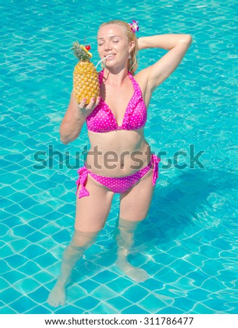 Blonde Woman In a Pool  - stock photo