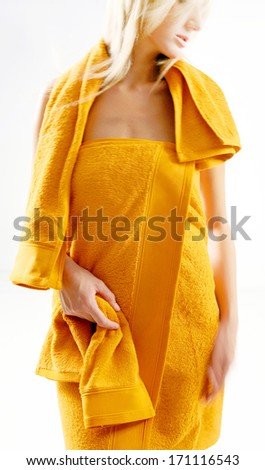blonde woman in orange towel - stock photo