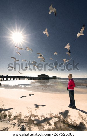 Blonde woman looking seagulls of mississippi beach - stock photo