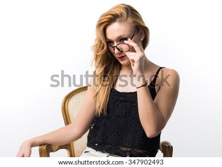 Blonde woman on vintage armchair - stock photo