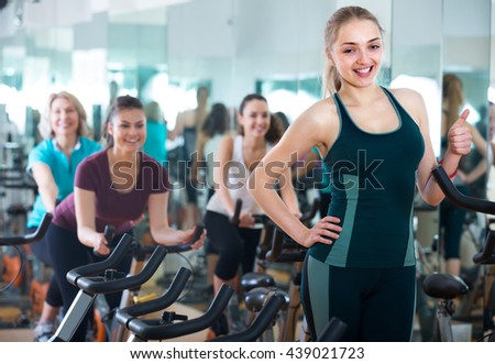 blonde woman 20s posing in modern gym for females - stock photo