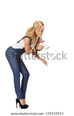 Blonde woman shouts at someone small. Domination concept - stock photo