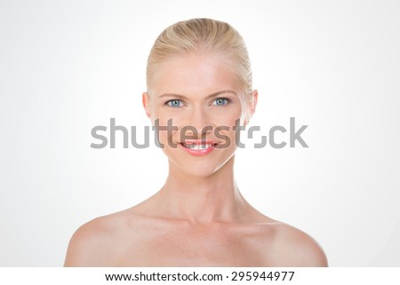 blonde woman shows a big bright smile - stock photo
