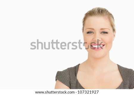 Blonde woman smiling against white background - stock photo