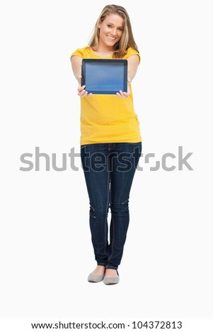 Blonde woman smiling while showing a touch pad screen against white background - stock photo
