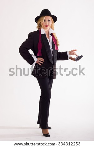 Blonde woman with gun - stock photo