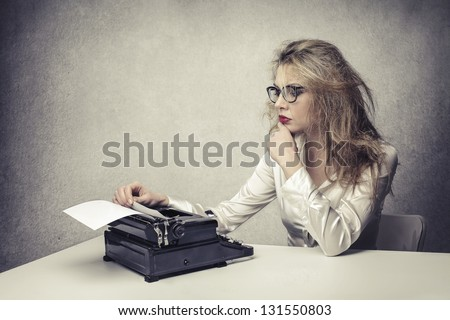 blonde writer reads text - stock photo
