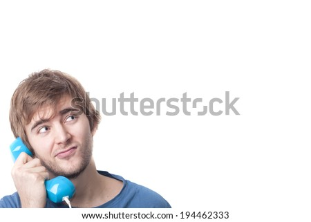 Blonde young male on telephone looking at imaginary information text of communications contract. Copyspace - stock photo
