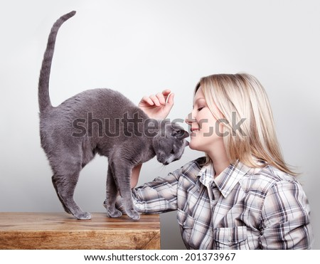 Blone Woman with Russian Blue Cat showing her affection - stock photo