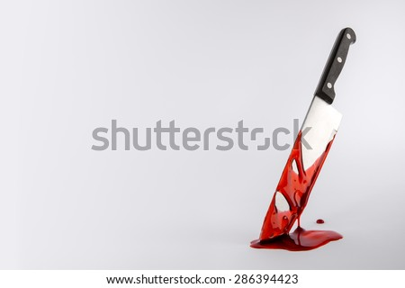 Blood drenched Kitchen knife in pool of blood with copy space - stock photo