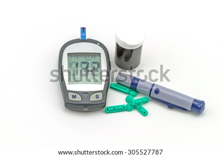 blood glucose meter test kit, the blood sugar value is measured on a finger - stock photo