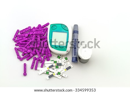 blood glucose meter, the blood sugar value is measured on a finger on white background. - stock photo